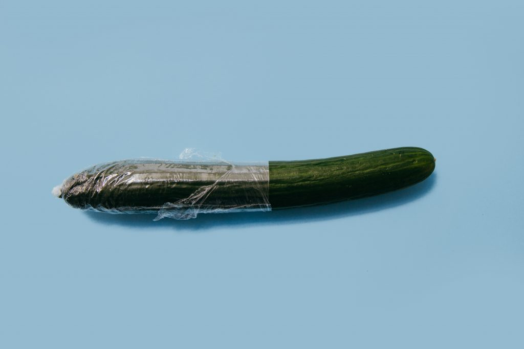 A cucumber with clear wrapping to suggest proper condom use
